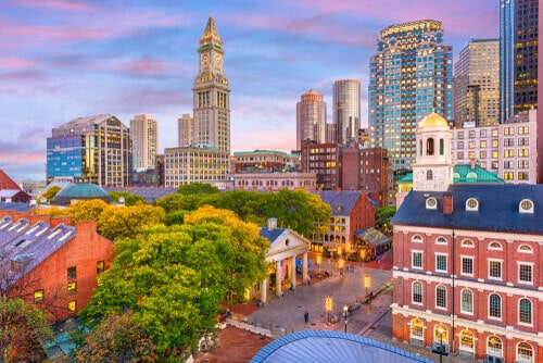 Boston, Massachusetts, skyline with Faneuil Hall and Quincy Market at dusk.